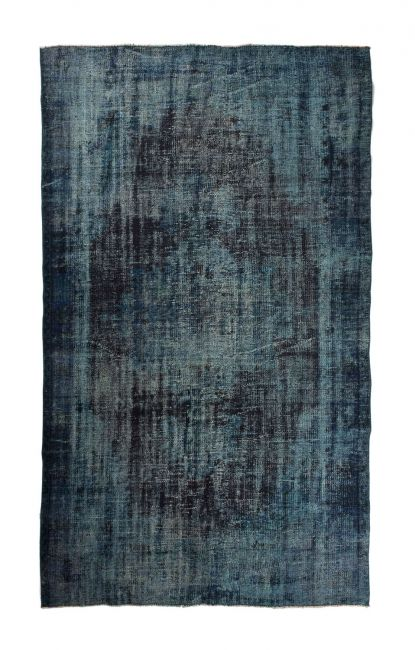Authentic bleached and overdyed carpet, in the color turquoise blue. FTWL brings you the most beautiful recoloured carpets and patchwork carpets. Check the collection to see all colored rugs in stock. Dyed carpets in every colour!