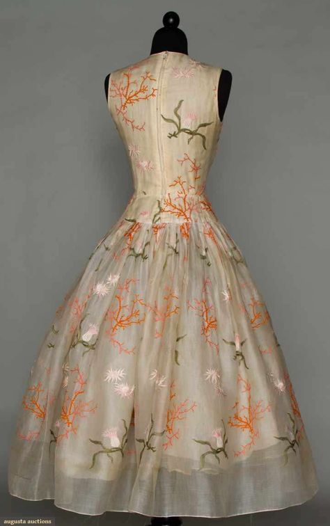 NORELL EMBROIDERED WHITE PARTY DRESS, c. 1954 Cotton organdy w/ orange coral, pink sea anemone & green frond embroidery, sleeveless, fitted & drop waist bodice, knife pleated voluminous bell skirt; 4 attached petticoats. Back