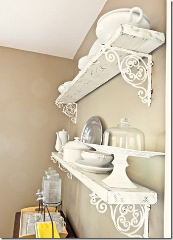 Distressed board shelves with ornate brackets