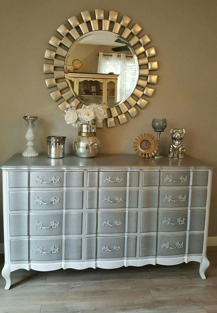 """Upcycled vintage French Provisional wavy drawer dresser used as a buffet. Silver metallic top, white, gray chalk paint then on the sides gray washed and distressed. The knobs were layered in Rustoleum spray paint. I added a bit of shimmer on the drawers for a little extra """"bling"""". Love the end result. You can see more on my FB page ChicandShabbyFurnitureByRebecca"""