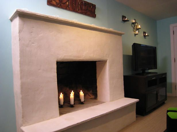 How To: Resurfacing a Fireplace  A stone fireplace gets a facelift with a contemporary stucco finish.