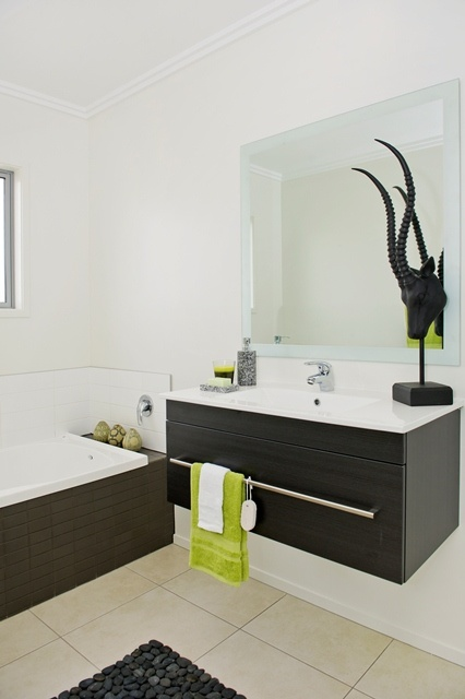 Wall hung vanity and funky feature sculpute in the bathroom.