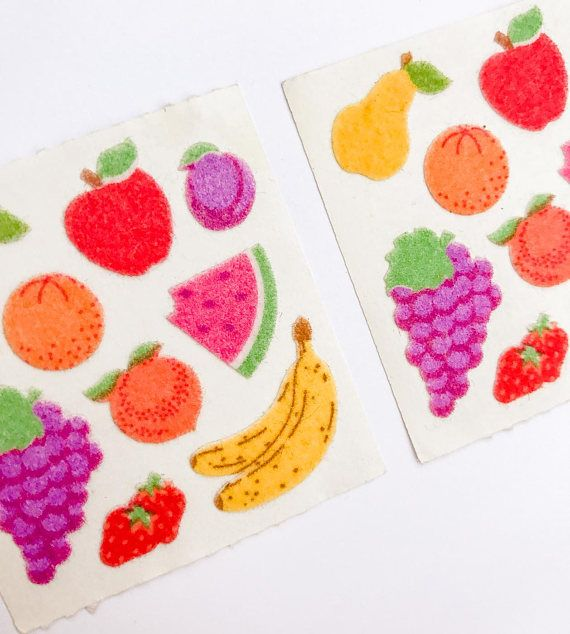 Two vintage Sandylion fuzzy fruit sticker squares. There are nine fruit stickers on each sticker sheet, never removed from backing and in excellent condition.  Fruits in this set: A pear, grapes, orange, strawberries, bananas, watermelon, apple, plum, and a peach.  ***** Please note items are being shipped via ground shipping with Canada Post. Tracking and insurance is not included in this standard shipping rate. If you would like to receive a tracking number, kindly let us know!