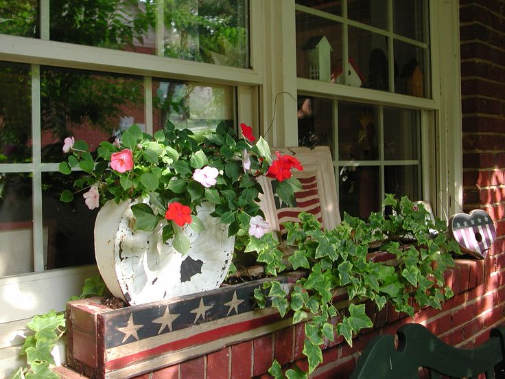 Summer on the side porch. I love putting flowers outside in front of my windows. It makes it brighter inside the house