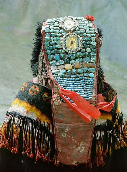 """Perak headdress """"The Ladakhis believed that the headdresses should be worn whenever women crossed streams or even went outdoors during the growing season, so the soil and woods would not be harmed.""""  http://www.peacefulsocieties.org/NAR07/070510lada.html"""