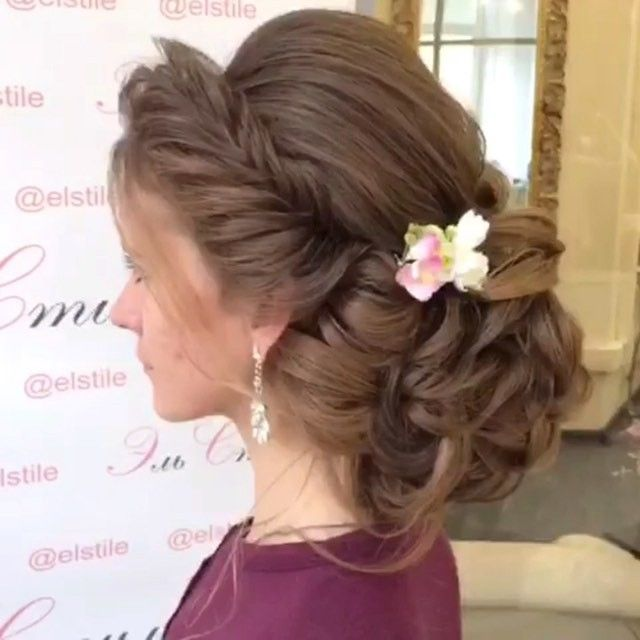 video example of a low bun with a braid.This low bun is pretty but I prefer more loose ringlets falling down from the bun and around my face, and the bun more to the side