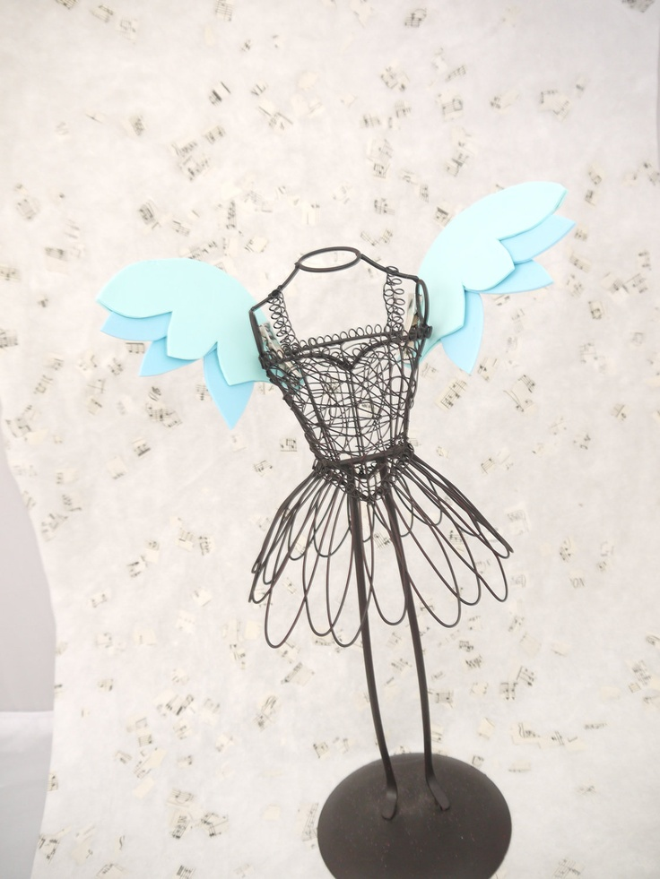 I like the dress form more than the wings.  :)