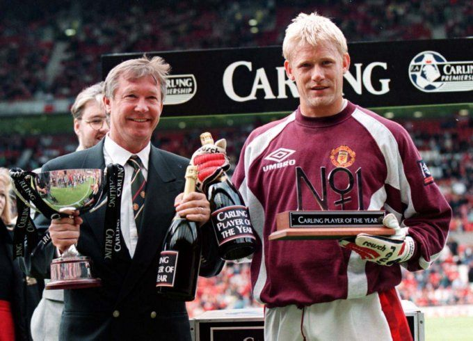Ferguson and Peter Schmeichel collect their respective 'Manager of the Year' and the 'Player of the Year' awards before the kick off against Blackburn on the first day of the 1996/97 season