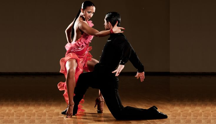 Two dancers dancing with their passion clear to see.