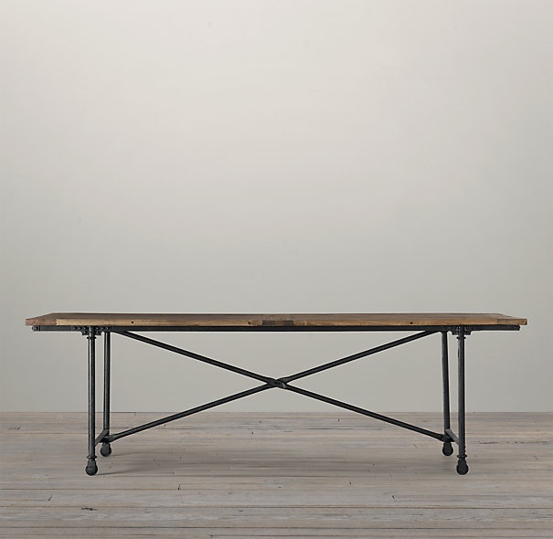 We're considering this Restoration Hardware dining table to use as a desk for my husband. It's nice and big and he needs that.