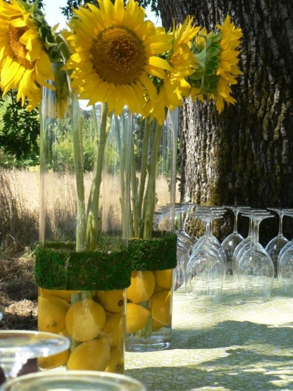 I love working with lemons-they are bright and cheery and helped make us feel cool in this 100+ degree day.  The vases were wrapped with moss ribbon found at a local craft store.