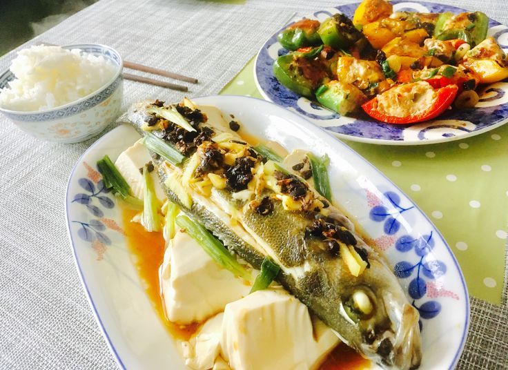 And on tonight's menu: Silken Tofu on Steamed Sea Bass with Black Bean Sauce, and in the background, Pan Fried Shittake mushrooms, pork and prawns encased in peppers.