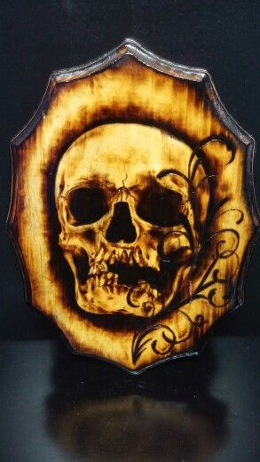 Skull and filigree wood burning