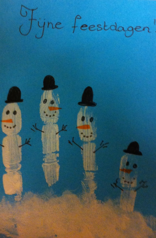 Kerstkaart gemaakt met een handafdruk, leuk voor de kids!
