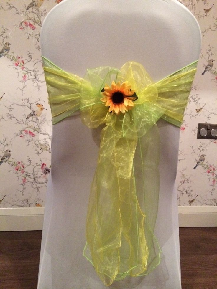One of our beautiful chair cover designs. Lime and sunshine yellow organza sash with a sunflower centre detail. Contact us for more design ideas. www.lakelandevents.co.uk