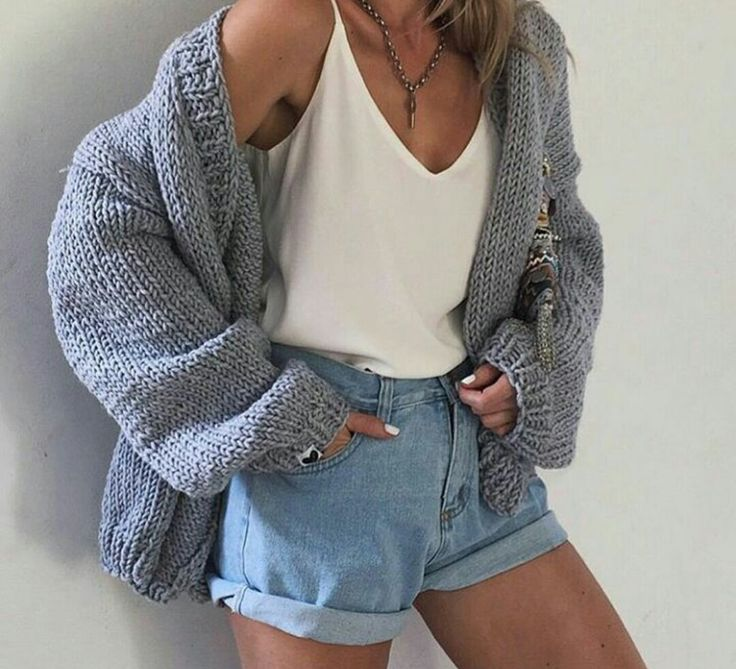 Chunky knit cardigain with loose top and deep V. High rise shorts with medium wash