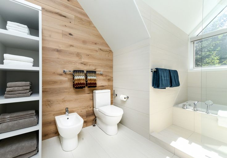 Falken Reynolds - Glacier Drive Master Bathroom - www.falkenreynolds.com   #watercloset #toilet #bidet #wood #wall #angle #tub #towels #storage #tile #bathroom #washroom