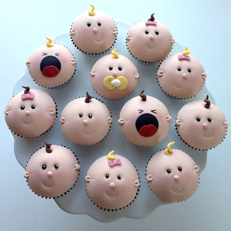 "Baby cupcakes! Pretty fondant! easy rolled curly cues for hair -  some pink ""pearl dust"" for the blush in the cheeks"