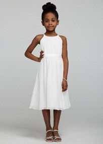 Simply beautiful, this chiffon tea length flower girl dress is a picture of perfection!  Spaghetti strap flower girl dress features stunning ruched bodice and empire waist.  Tea length chiffon skirt is both classy and fun.  Available in Soft White.  Fully lined. Back zip. Imported polyester. Dry clean.