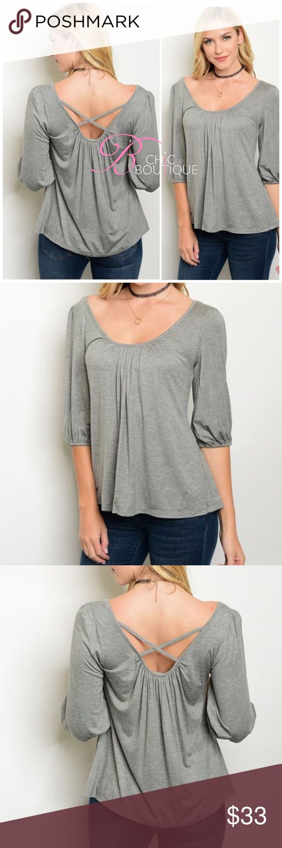"""❗Clearance❗Criss Cross Back Grey Top 3/4 smock sleeve scoop neck jersey top featuring criss cross style on the back. Made of Rayon/ spandex blend. Measurements for small length 25"""" Bust 40"""" Bchic Tops"""