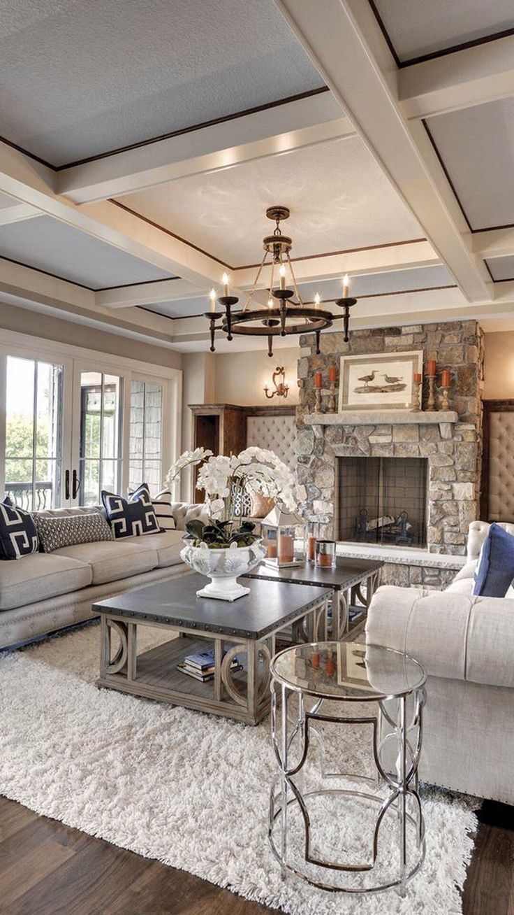 Luxurious Living Room With Stone Fireplace And Coffered Ceiling