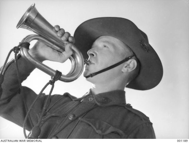 An audio clip of The Rouse available online and for download on the Australian War Memorial site. This image is in the Public Domain. Private R. Thompson, 2/2nd Battalion, of Sydney, NSW playing his bugle in Gaza village Palestine