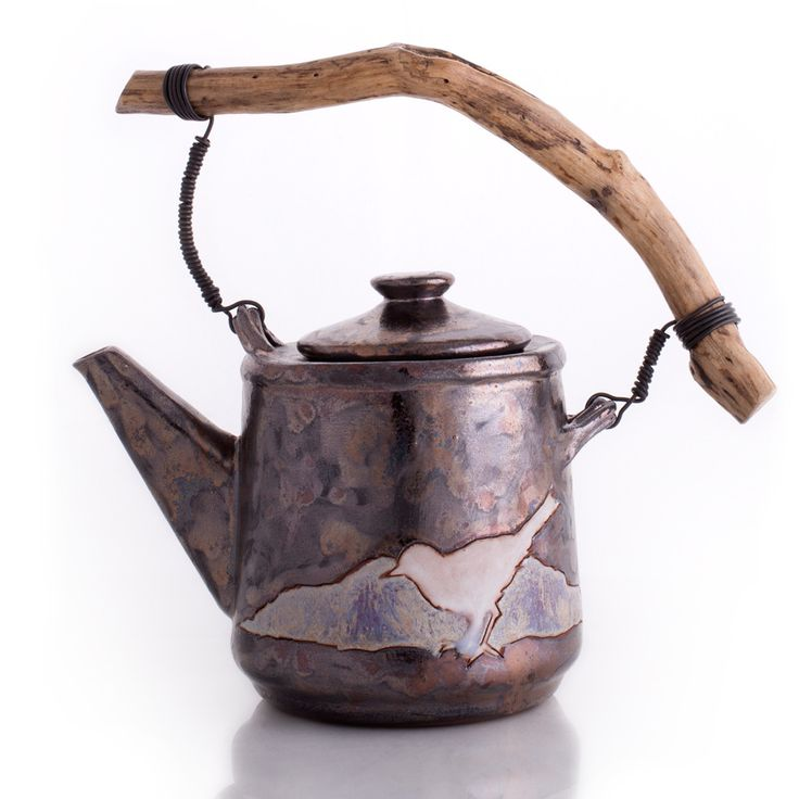 """Handcrafted with impressive artistry, Bird teapot will certainly add a special touch to every tea service. The handle, made of wood, empasizes its rustic feel. Details and Dimensions - W 4"""" x H 4.8"""","""