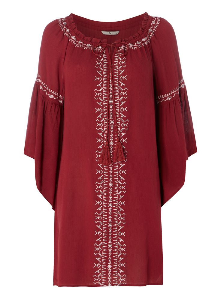 """Introduce a bohemian-chic feel to your wardrobe with this embroidered tunic. Designed with bell sleeves and a self-tie neckline, it teams perfectly with denim shorts.<br /><ul><li>Red crinkle embroidered tunic</li><li>Crinkled effect</li><li>Embroidered detail</li><li>Bell sleeves</li><li>Tasselled detail</li><li>Model's height is 5'11""""</li><li>Model wears a size 12</li></ul>"""