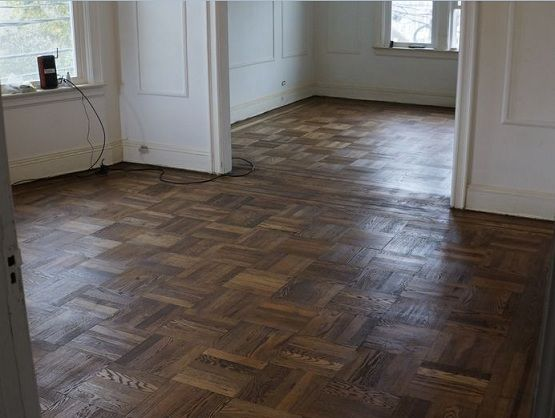 Refinishing Parquet Flooring With Cool Dark Color The