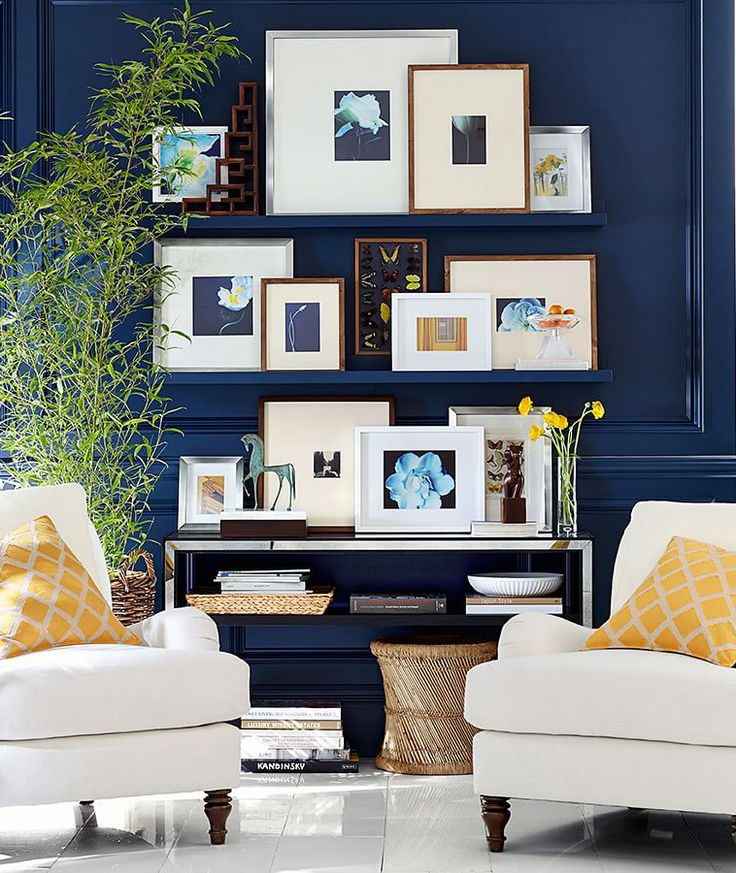 Use open shelves with framed photos in a more casual gallery wall display.