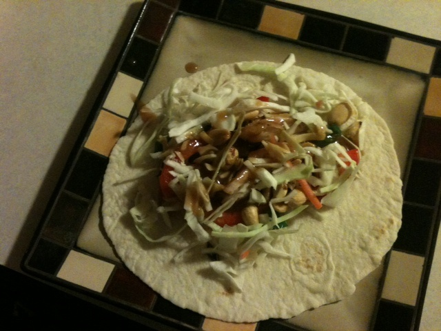 Grilled chicken, cabbage slaw, green onions, red bell pepper, peanuts on a low carb tortilla with a peanut ginger dressing.  Oh so good!  If you want the recipe, just ask and I'll post it!: Recipe, Peanut Gingers