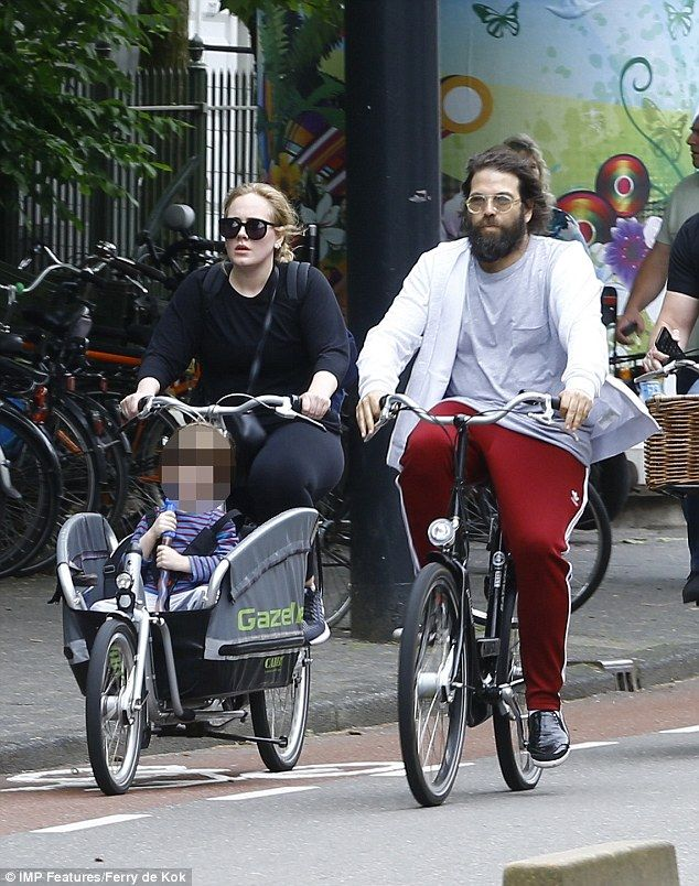 Picture Exclusive: Rolling in the streets: Adele and Simon Konecki take their son Angelo on a family bike ride around Amsterdam