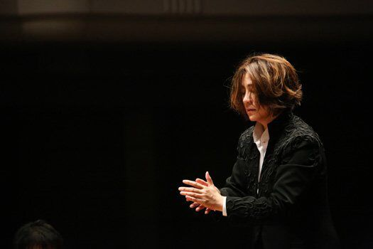Tomomi Nishimoto, conductor.   Mhmmmmm.