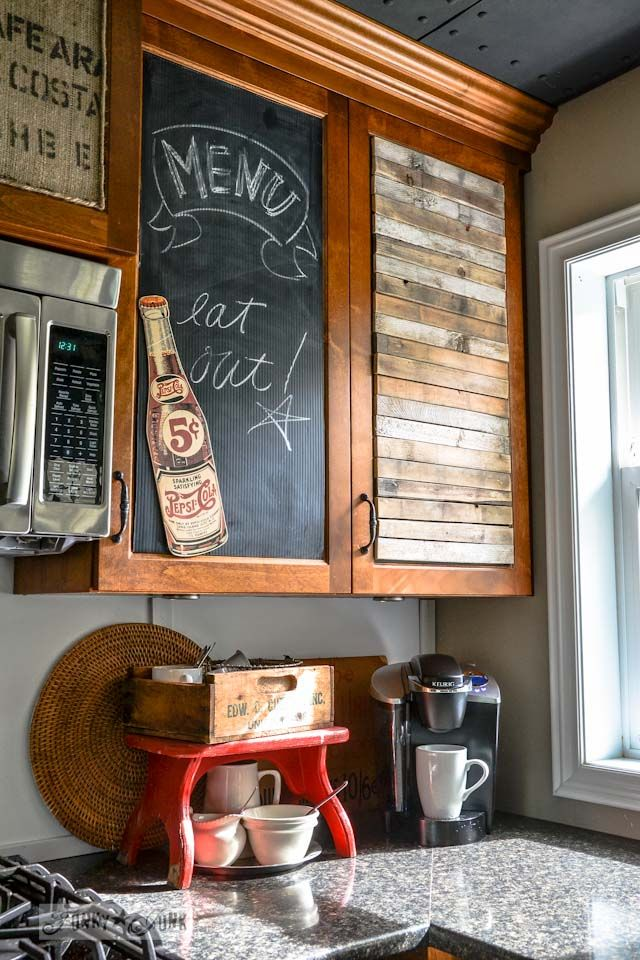 Love this idea! Literally taking whatever and with the use of carpet tape transformed the cabinets into something personal. The best part is its can be permanent or temporary.