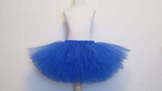 Royal Blue Tutu Skirt Boutique tutu with over 50 yards of tulle is used to make this boutique tutu. Hand tied to perfection to elastic waistband. Very stretchy and made to be worn as your peanut grows