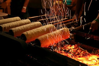 Destination Romania - traditional way of baking Kurtos Kalac chimney cake