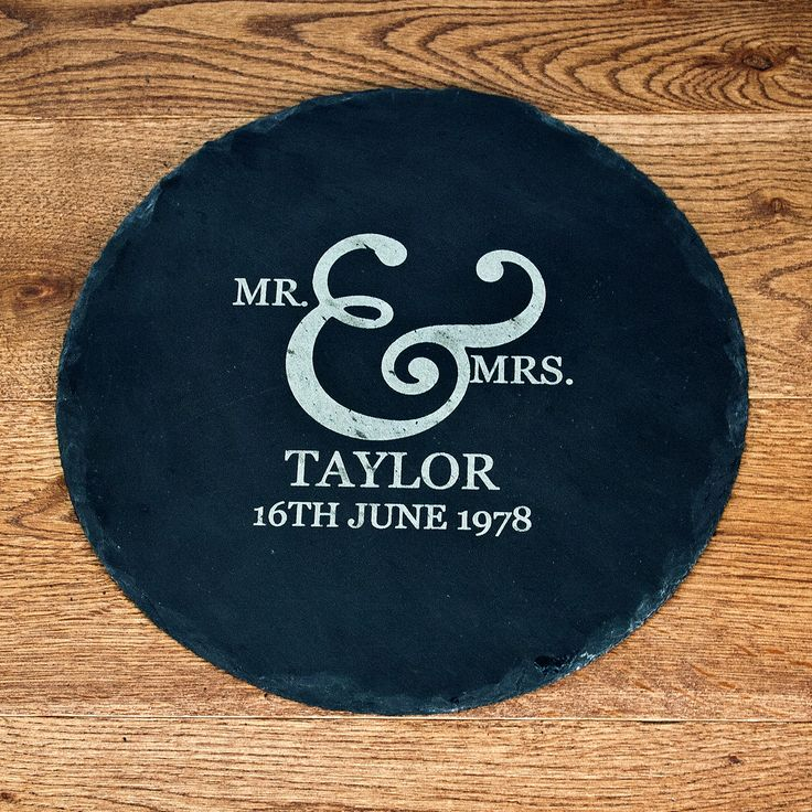 This beautiful round slate cheese platter is personalised with a Mr and Mrs Romantic Swirl Ampersand Design.  The slate has natural edges which adds to the rustic feel of the piece.  •    Great gift for weddings, housewarming gifts, birthdays and christmas. •    Slate plate diameter is 25cm •    Personalise with a surname and a special date •    Personalisation detail is engraved into the slate  Surname - 14 characters Date - 18 characters