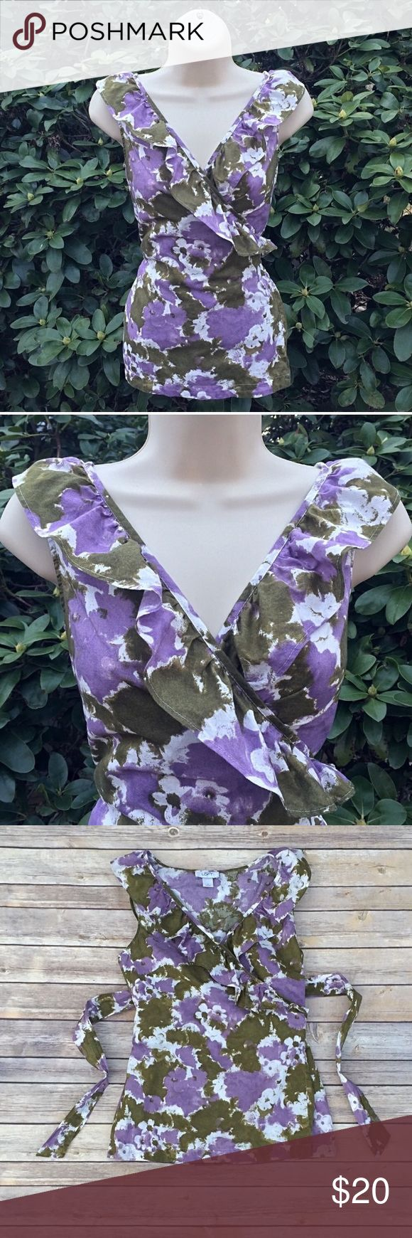 Gorgeous purple and green floral wrap top Super cute sleeveless floral wrap top from LOFT.  It has ruffles around the neckline and a cross-over v-neck.  Long ties to wrap and adjust waist and chest size.  100% cotton.  Excellent condition.  Size small - see picture for exact measurements. LOFT Tops