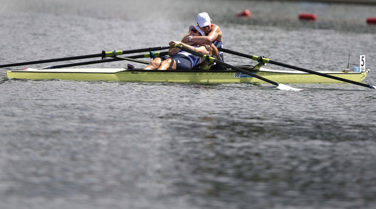 Great Britain's Katherine Grainger and Anna Watkins, right, embrace after winning the gold medal for the women's rowing double sculls in Eton Dorney, near Windsor, England.