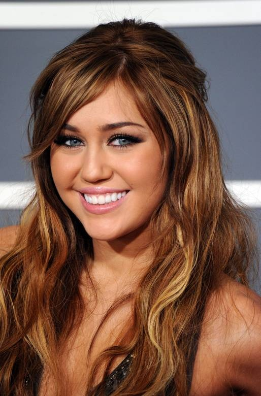 Miley Cyrus when she was pretty.... why did she get the ugly hair and go emo?!