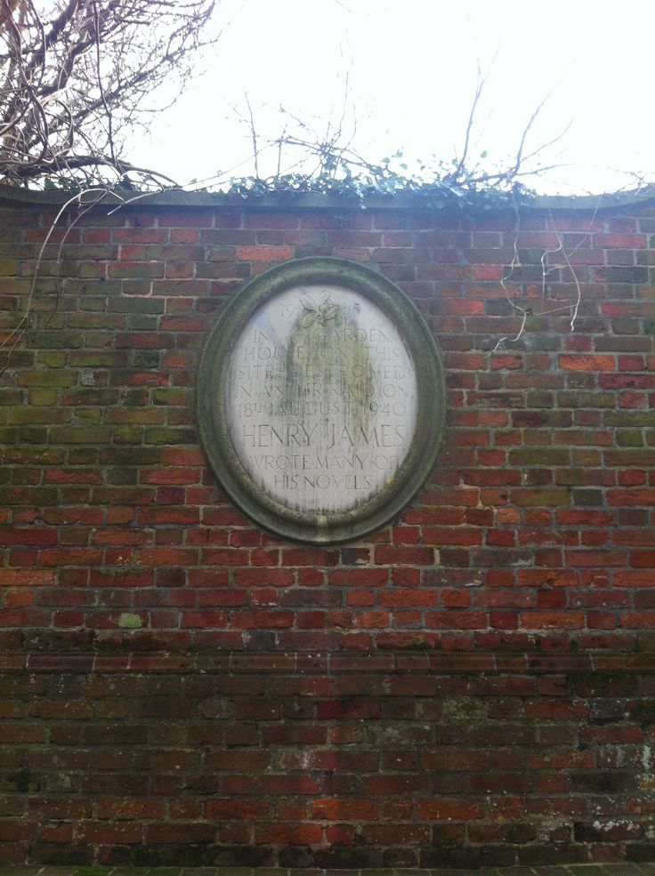 plaque reads: In a garden house on this site- destroyed in an air raid on 18th August 1940- Henry James wrote many of his novels