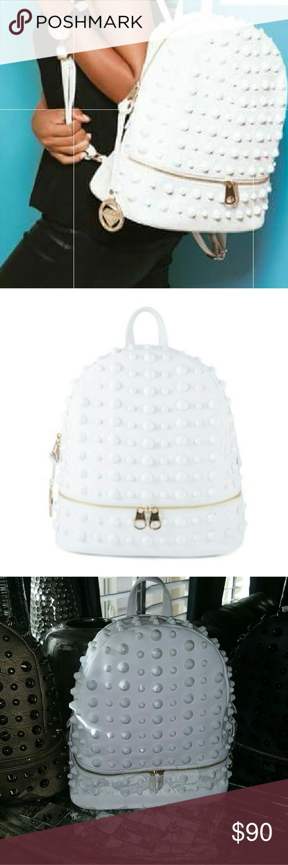 Traci Lynn White Studded backpack Stud and Chic White Backpack with gold hardware. Inside pockets for cell phone & glasses also a zippered pocket inside. Don't let this beautiful backpack pass you by. Bags Backpacks
