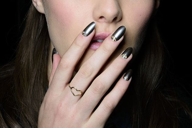 Nail Trends 2014 - Sparkling Halfmoons - Add a touch of sparkle to your nails by focusing on the halfmoon. Badgley Mischka opted for gunmetal with sparkling halfmoon, while Rolando took a less contrasting approach, but just as charming and effective in creating a unique look.
