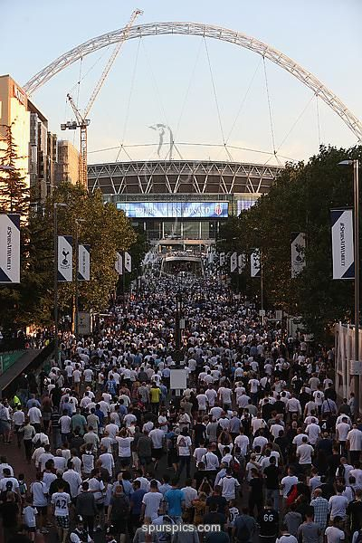 LONDON, ENGLAND - SEPTEMBER 14: Tottenham fans make their way to Wembley prior to the UEFA Champions League match between Tottenham Hotspur FC and AS Monaco FC at Wembley Stadium on September 14, 2016 in London, England