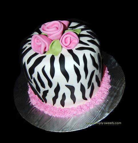 Zebra print cake with pink roses.