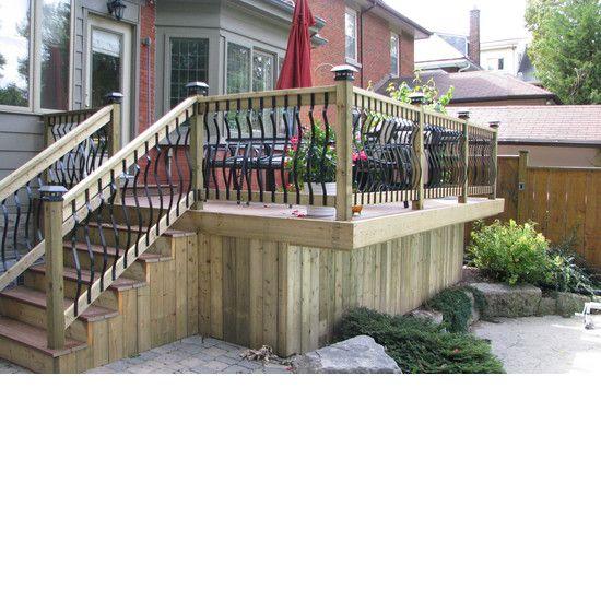Custom wood deck with metal spindles