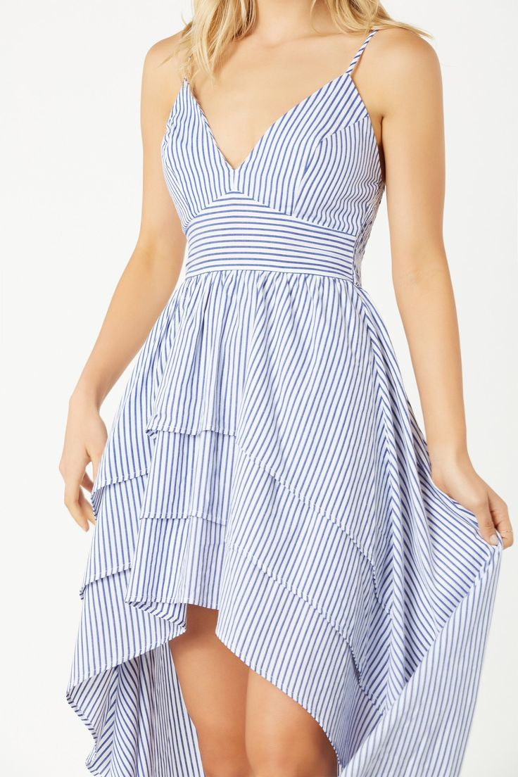 Sleeveless hi-low dress with stripe patterns throughout. Ruffle tier design with flowy hem finish.