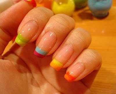 I really like the designs on this page - there are a ton - but several aren't practical - I can't go around with stuff hanging off my nails. This multi-color rainbow French manicure, on the other hand, is gorgeous & practical.