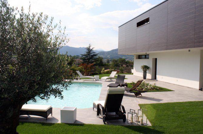 Giardino con piscina villa bifamiliare a Paratico - architettura