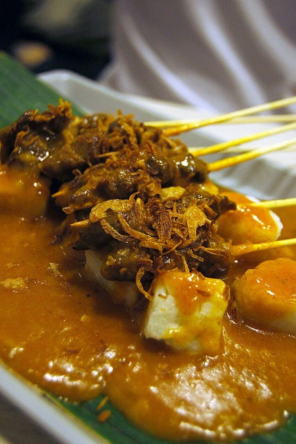Satay Padang- Indonesian Food- This looks like a super delicious satay...the yellow sauce is a killer...goes best with the rice cakes and the juicy grilled beef